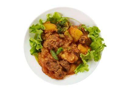 East African cuisine - Somali  Lamb and Potato Sugo, tasty meat and vegetable dish , Traditional assorted African  dishes, Top view. Stock Photo
