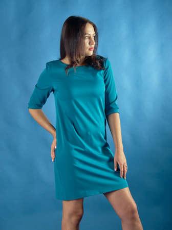 Portrait of beautiful brunette smiling over  blue backgroundwith copyspace Stock fotó