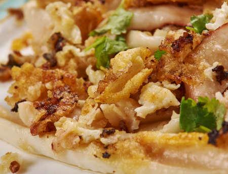 Roman-style calamari, quid slices fried close up Foto de archivo