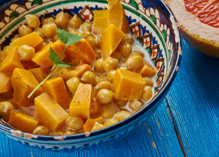 Moroccan cuisine, Chickpea Squash Tagine, Traditional assorted Moroccodishes, Top view.