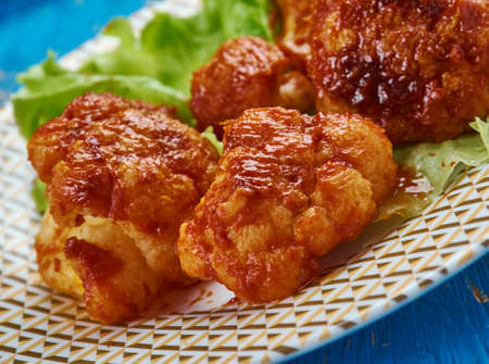 Crispy Buffalo Fried Cauliflower -  battered cauliflower tossed in garlicky buffalo sauce.