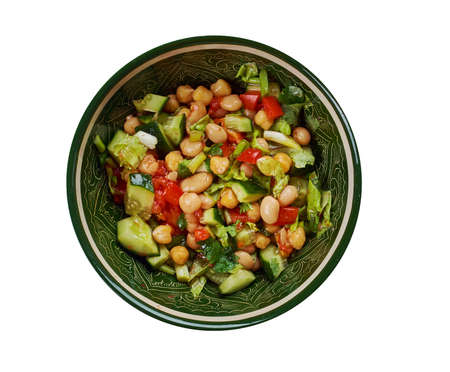 Balela - Middle Eastern-style bean salad, made with garbanzo and black beans, plus lots of sweet grape tomatoes Archivio Fotografico - 97462308