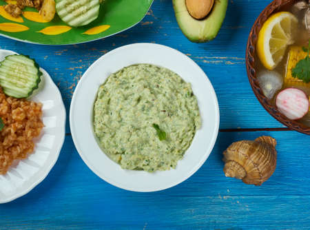 Mexican cuisine , Avocado Salsa Verde, Traditional assorted Aztecs dishes, Top view.