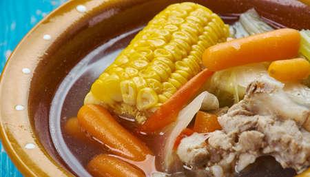 Caldo de Res  -  Mexican Beef Soup , made from scratch with beef bones, cabbage, potatoes, corn, chayote, and cilantro Foto de archivo - 97845272