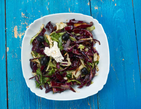 Red Cabbage Mojo Slaw - Cuban Mojo sauce is made with tons of garlic, fresh orange juice, and lots of oregano and cumin.