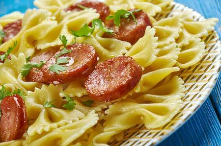 One Pot Kielbasa Pasta,  smoked kielbasa with pasta Farfalle Standard-Bild - 102735553