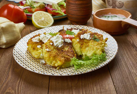 Kolokythokeftees, zucchini tots, Greek  cuisine , Traditional assorted dishes, Top view.