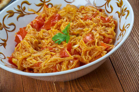 FooSev Tameta Nu Shaak , d set dish from Southern India,Gujarati style sweet and sour tomato curry prepared with tomato, sev, onion and other Indian curry spices