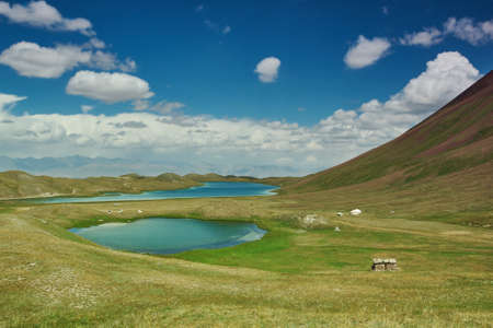 Alay Valley of Osh Region, Kyrgyzstan, blue sky over few small beautiful lakes