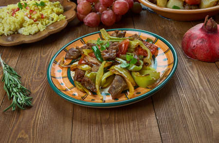 Ker-u-sus , Armenian cuisine, dish made with fried beef skirt steak and peppers,Traditional assorted dishes, Top view. Stock fotó