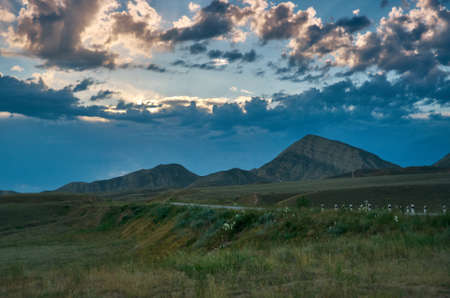 Toktogul reservoir , Scene at sunset, Kyrgyzstan, Jalal-Abad Province Фото со стока