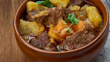 Karjalanpaisti, Karelian hot pot, traditional meat stew originating from the region of Karelia, Finnish cuisine, Traditional assorted dishes, Top view. Stock Photo