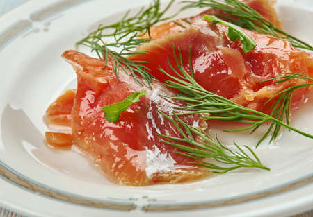 Graavilohi - Nordic dish consisting of raw salmon, cured in salt, sugar, and dill.
