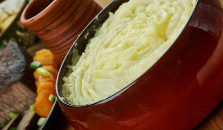 Shepherd's pie, cottage pie is a meat pie with a crust or topping of mashed potato,  English cuisine, Britain Traditional assorted dishes, Top view.