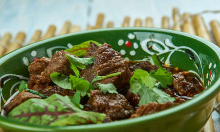 Tawa mutton - Pakistani pan put mutton, chopped onion, ginger garlic paste, chopped tomatoes. Stock Photo