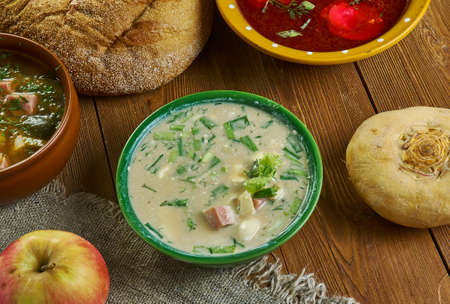 Okroshka, Russian traditional soups , assorted dishes, Top view.soup is a mix of mostly raw vegetables , boiled potatoes, eggs, and a cooked meat such as beef, veal