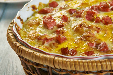 Twice Baked Potato Casserole, Smash the potatoes with a potato masher. Add the cheese, seasoned salt,Cheddar , sour cream, milk, butter, Stock fotó