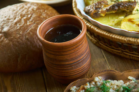 Medovukha - Slavic honey-based alcoholic beverage- Russian 19th century classic cuisine , assorted dishes, Top view. Stock Photo