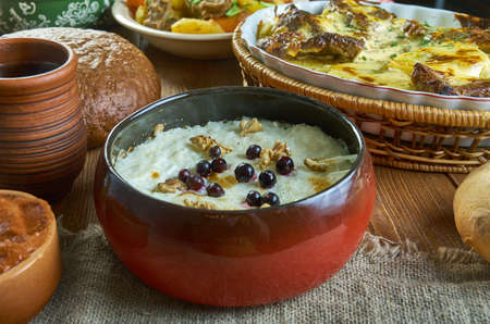 Guriev porridge Guriev kasha - ,dessert dish prepared from semolina and milk with the addition of nuts,  Russian 19th century classic cuisine , assorted  dishes, Top view. Stock Photo