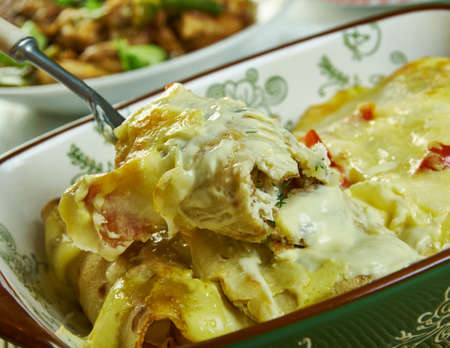 Creamy Pepperjack Chicken Enchiladas, loaded with enchilada sauce, sour cream Фото со стока