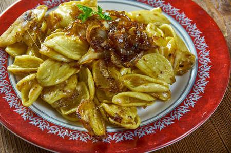 Kasespatzle -traditional dish of Swabia,  Switzerland, Liechtenstein of Austria.Hot spatzle and grated granular cheese