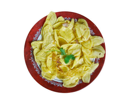 Kasespatzle - Hot spatzle and grated granular cheese , Austrian national  cuisine, Traditional assorted dishes, Top view.