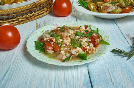 Utica greens, made of hot peppers, sauteed greens, chicken stock or broth, escarole, cheese, pecorino,Italian-American cuisine, Traditional assorted dishes, Top view. Stock Photo