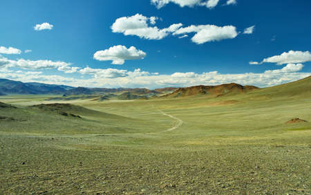 Mongolian Altai. Scenic valley on the background of the snowcapped mountains. Stock fotó