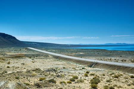 Highway in the neighborhood salt lake Khyargas Nuur