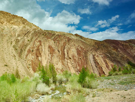 Red mountains in Kyzyl-Chin valley of the Chagan-Uzun river.  in Altay.