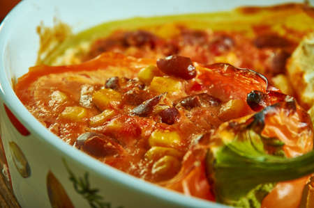 Chili Stuffed Spaghetti bell peppers , oasted spaghetti squash filled with a hearty two-bean vegetable chili