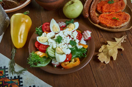 Ovcharska Salad, variation of the Shopska salad, Bulgarian, national  cuisine, Traditional assorted Balkans dishes, Top view.