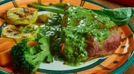 Steak de Burgo, steak dish and a regional specialty in the Midwest, specifically Des Moines, Iowa.beef tenderloin either topped with butter, garlic, and Italian herbs, or served in a sauce