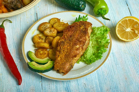 Jerk spiced fish, Caribbean cuisine, Traditional assorted dishes, Top view.