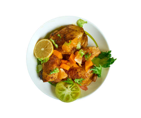 Jerk chicken thighs, Caribbean cuisine, Traditional assorted dishes, Top view.