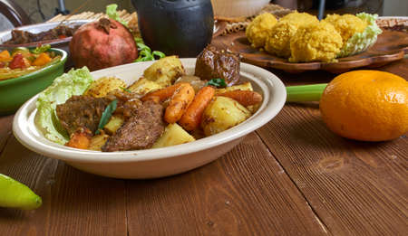 Jarret de boeuf, beef and vegetable stew., Chadian cuisine, Traditional assorted African dishes, Top view.