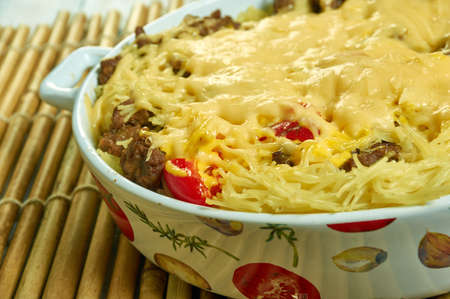 Million Dollar Spaghetti  Casserole with ground beef, butter, noodles, cheese/