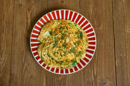 Tajine maadnous, Tunisian egg cake made of meat, cheese, bread crumbs, onion, parsley, tomato, and turmeric