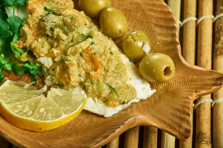Steamed Cod with Olive Tapenade, cod fillets on the prepared baking sheet, and season with salt and pepper.