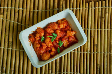 Gobhi Manchurian,  Indian cuisine fried cauliflower food item popular in India, dipping cauliflower florets in it and deep frying them