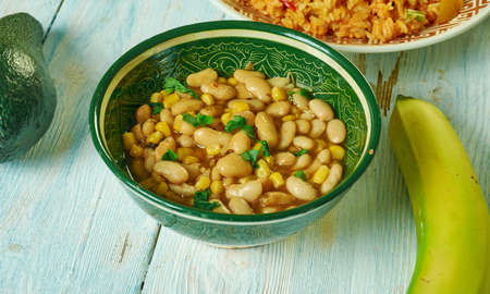 Githeri, maize and beans are mixed together in a sufuria,  Kenyan cuisine, Traditional assorted African dishes, Top view.