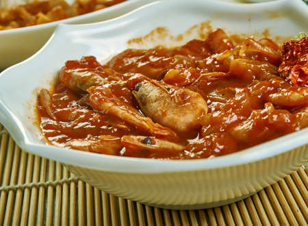 Balchao - fiery dish from Goa, spicy seafood or meat dish in Goan cuisine.