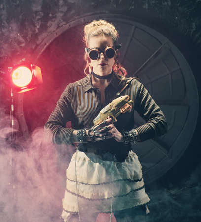 Steampunk woman with Sci fi gunl, model in the style of a steampunk in a beautiful creative studio. Fashion, style