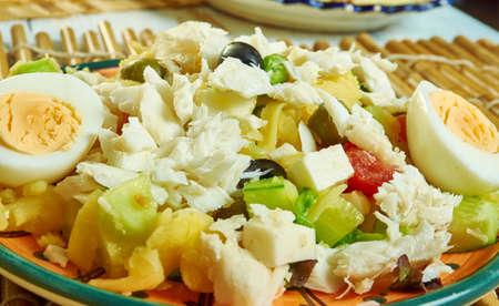 Portuguese salad with cod, potatoes - Bacalao or Bacalhoada