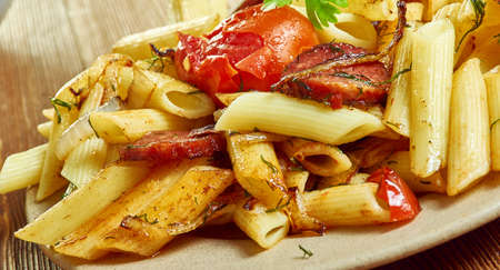 Penne with chorizo , caramelized onions , flavor to this penne dish.