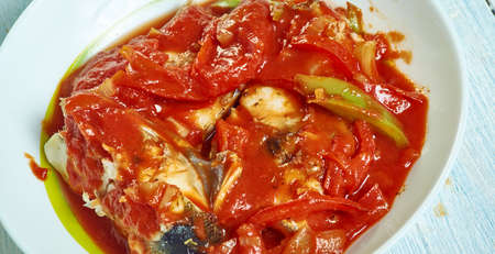 Trinidadian fish stew, Caribbean Fish ith marinated red snapper and tilapia, infused with spices, herbs bell peppers, tomatoes, Foto de archivo