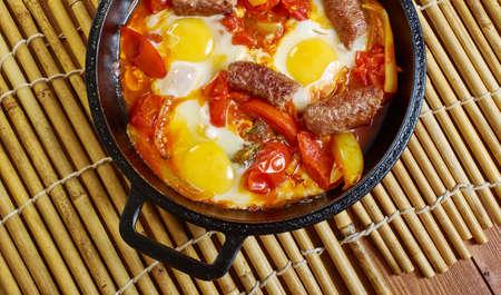 Middle Eastern eggs with merguez, swap for chipolatas or chorizo. Stockfoto