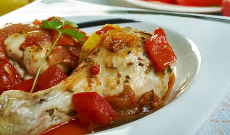 Pan Grilled Chicken in Peperonata. classic Italian side of tangy stewed peppers, Sicilian cuisine, Traditional assorted Italy dishes, Top view.