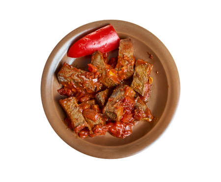 Drusan kebab - traditional Bulgarian dish consisting of cubed pork, tomatoes, dried peppers, and onions.