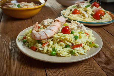 Seafood Alfredo Paella - Spanish seafood paella with melting cheese, spicy chillies, zesty greens